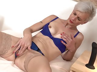 mature sexy mom feeding her vagina